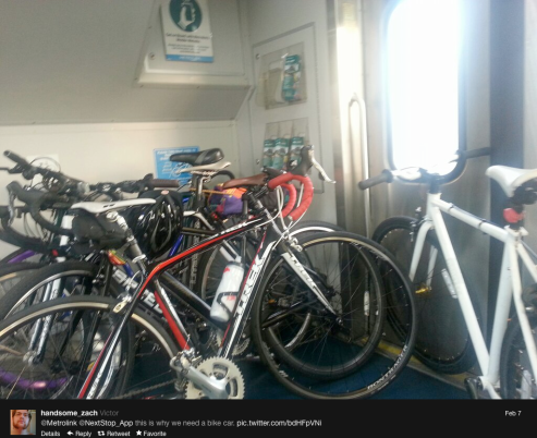 Crowded train car designed to accommodate only three bicycles.